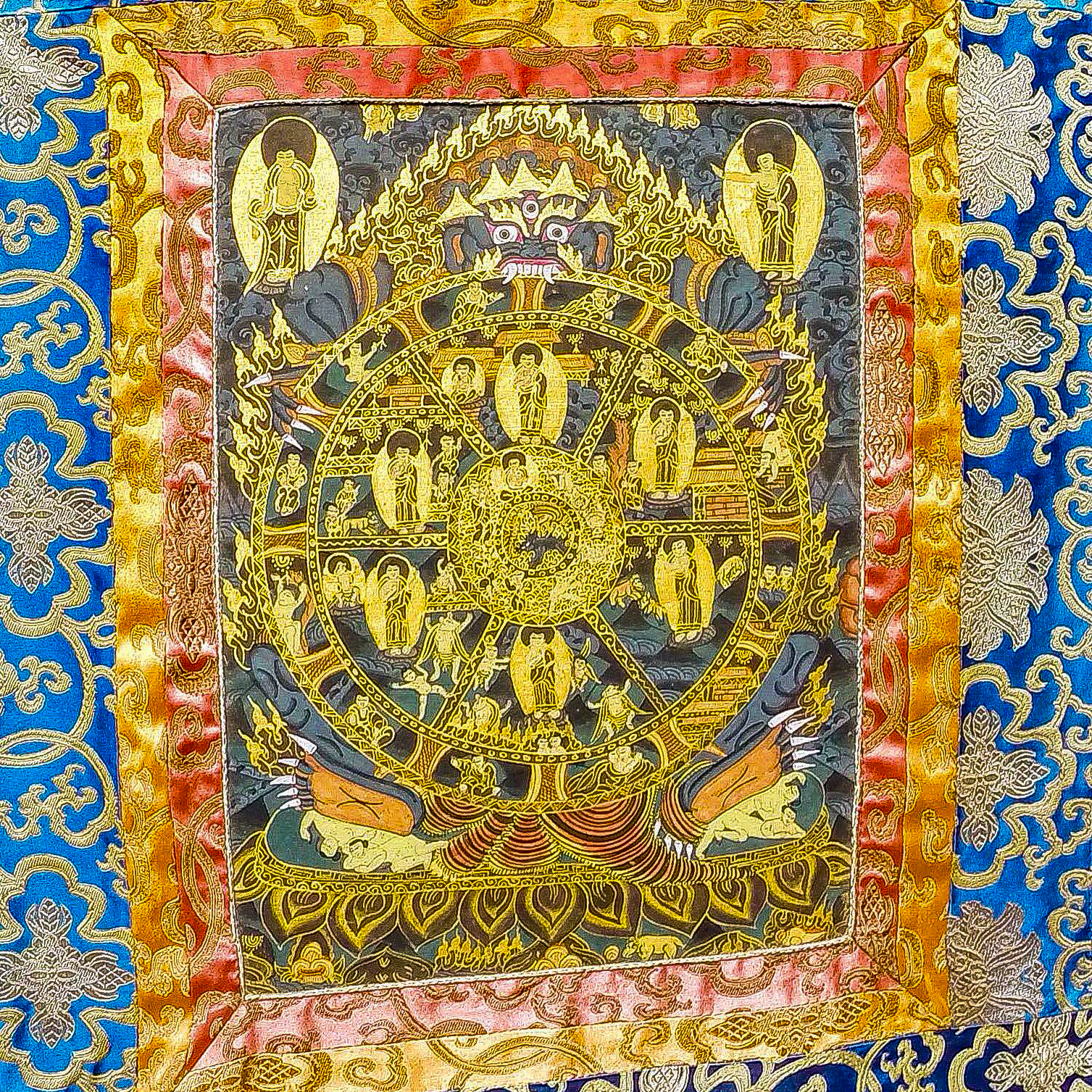 A tapestry depicting The Wheel of Life symbolizes the role of gods and karma in a Buddhist's journey to nirvana.