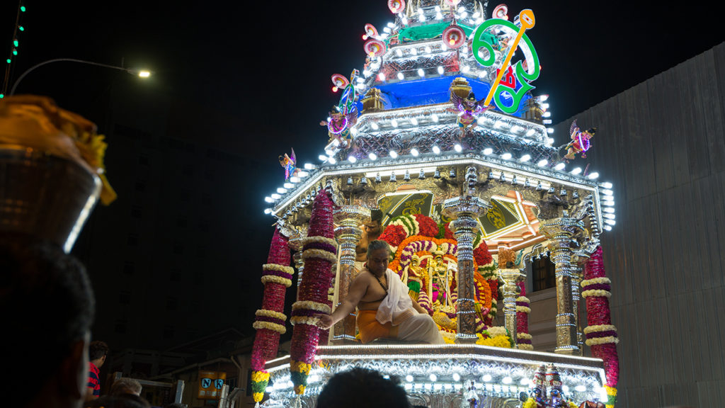 A chariot carries a statue of Lord Murugan.