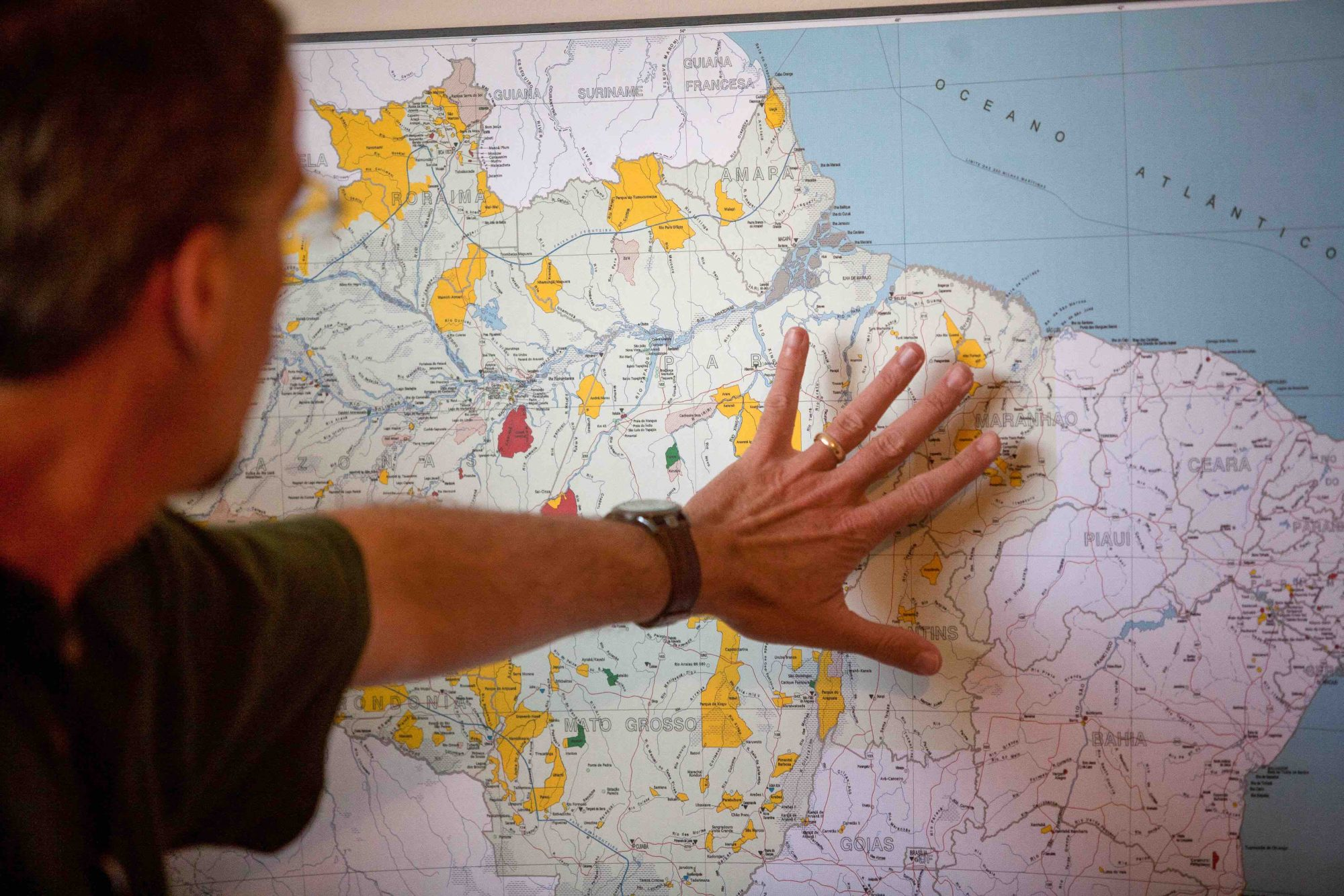 Missionary Looks at Map